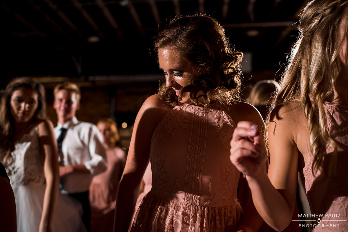 bridesmaid dancing at wedding reception at The Rutherford