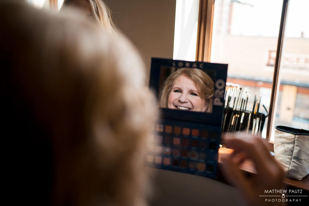 Mother of Bride looking in mirror