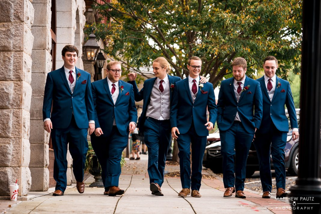 groomsmen walking to wedding ceremony