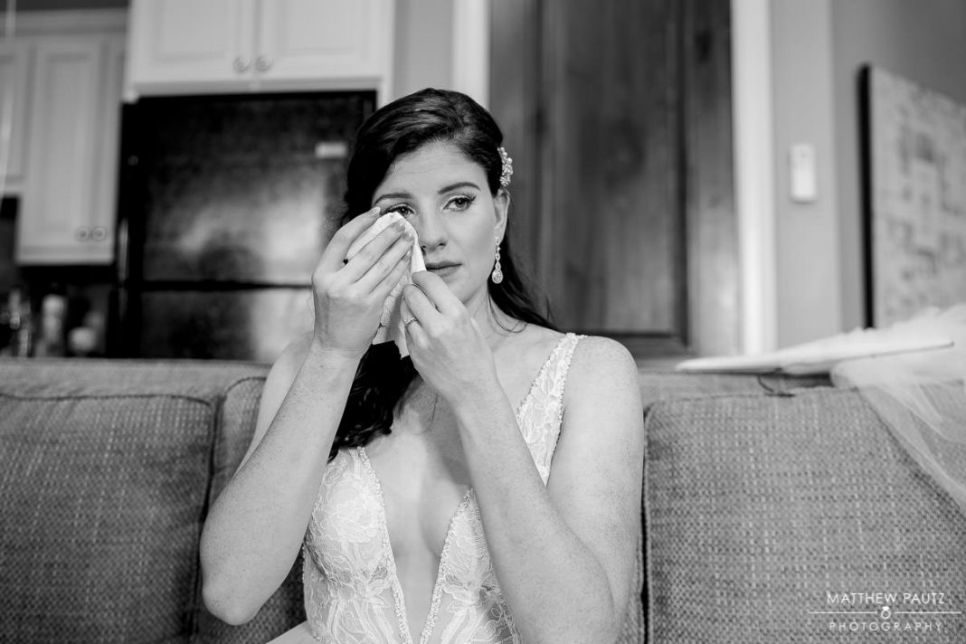 bride crying after pre-ceremony prayer