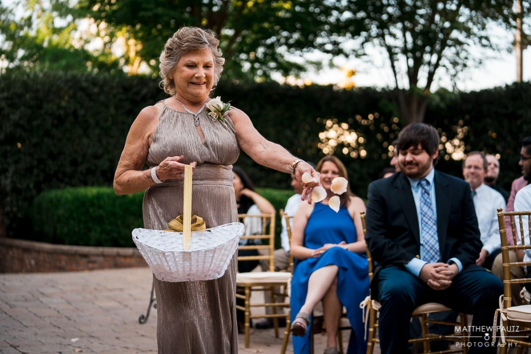 Grandmother acting as flower girl for wedding ceremony