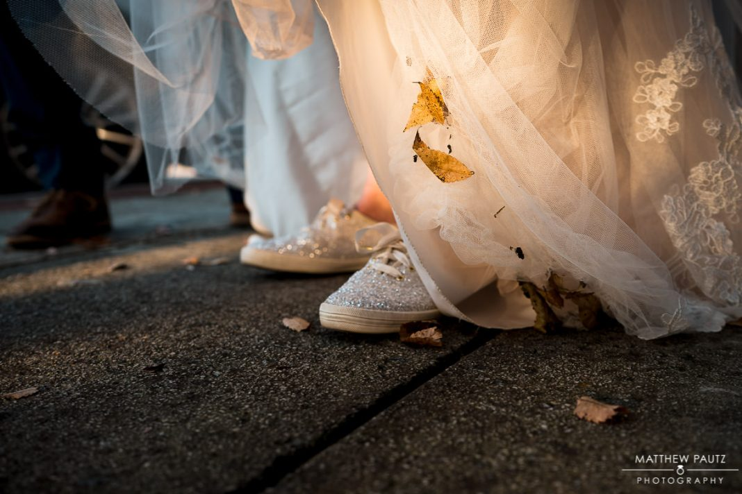 fall leaves stuck to bride's wedding dress