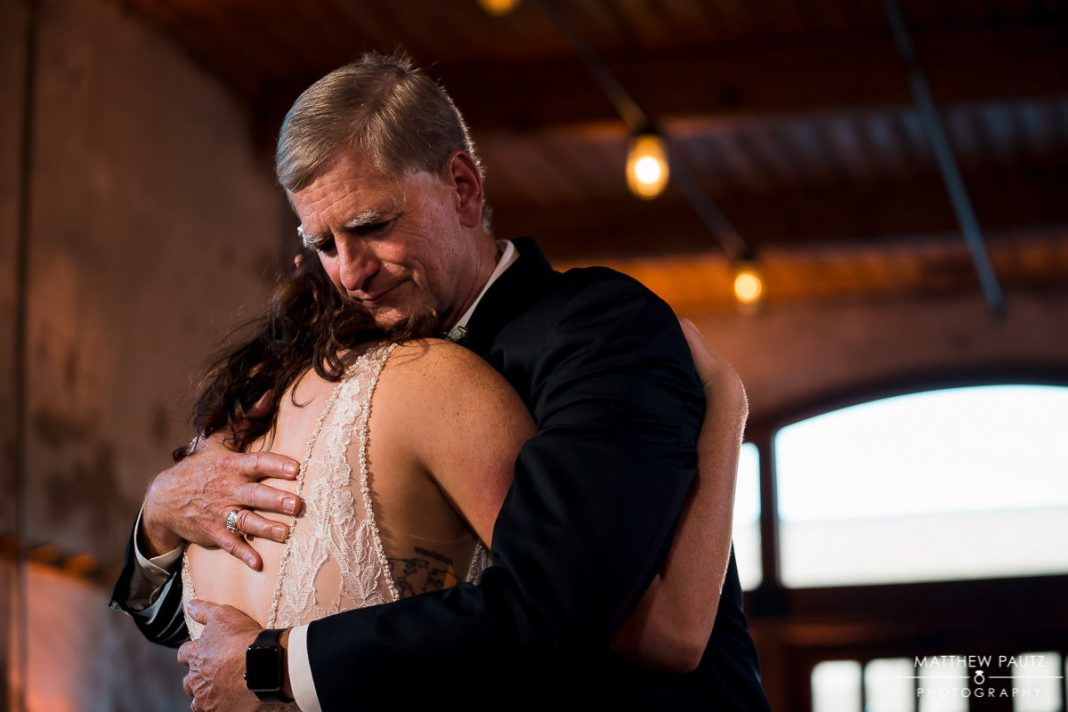bride dancing with father during wedding reception