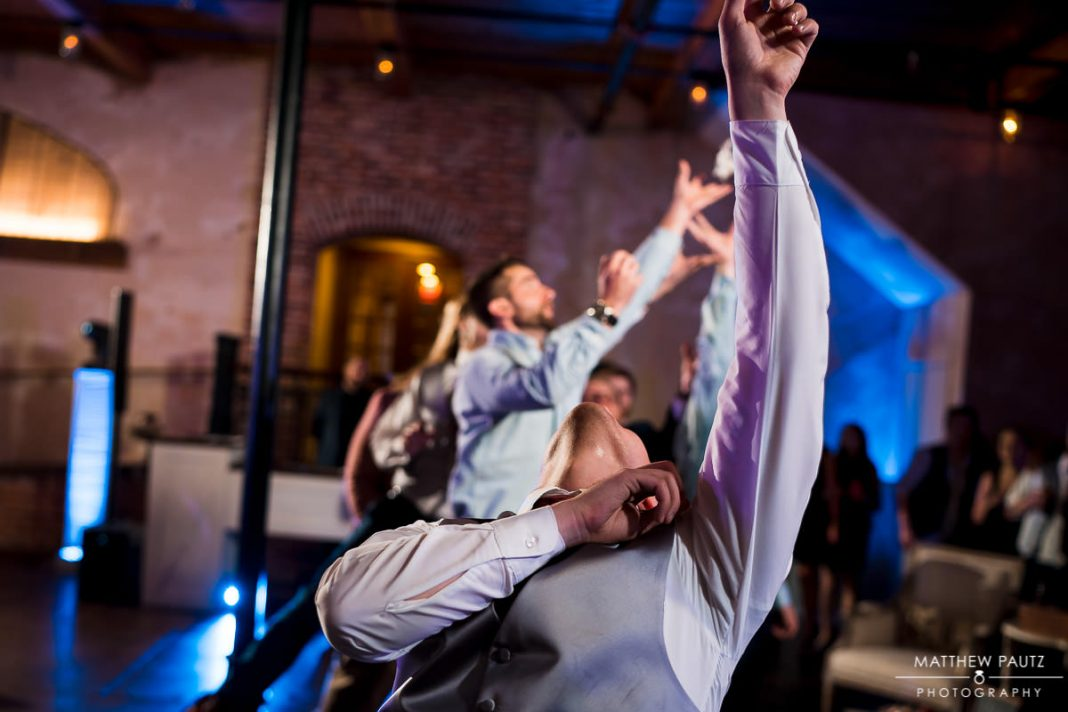 groom's garter toss at wedding reception