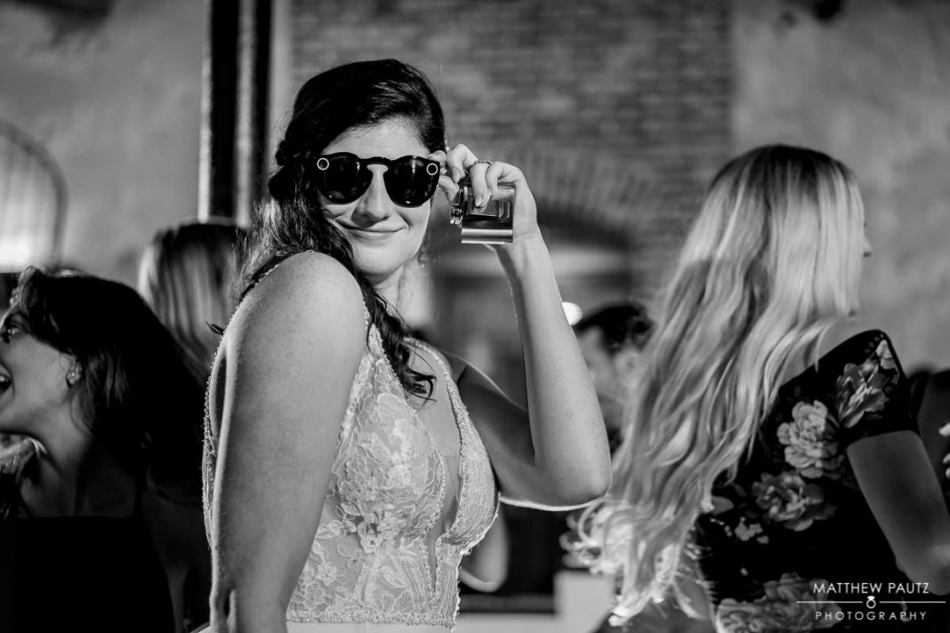 bride wearing sunglasses at wedding reception