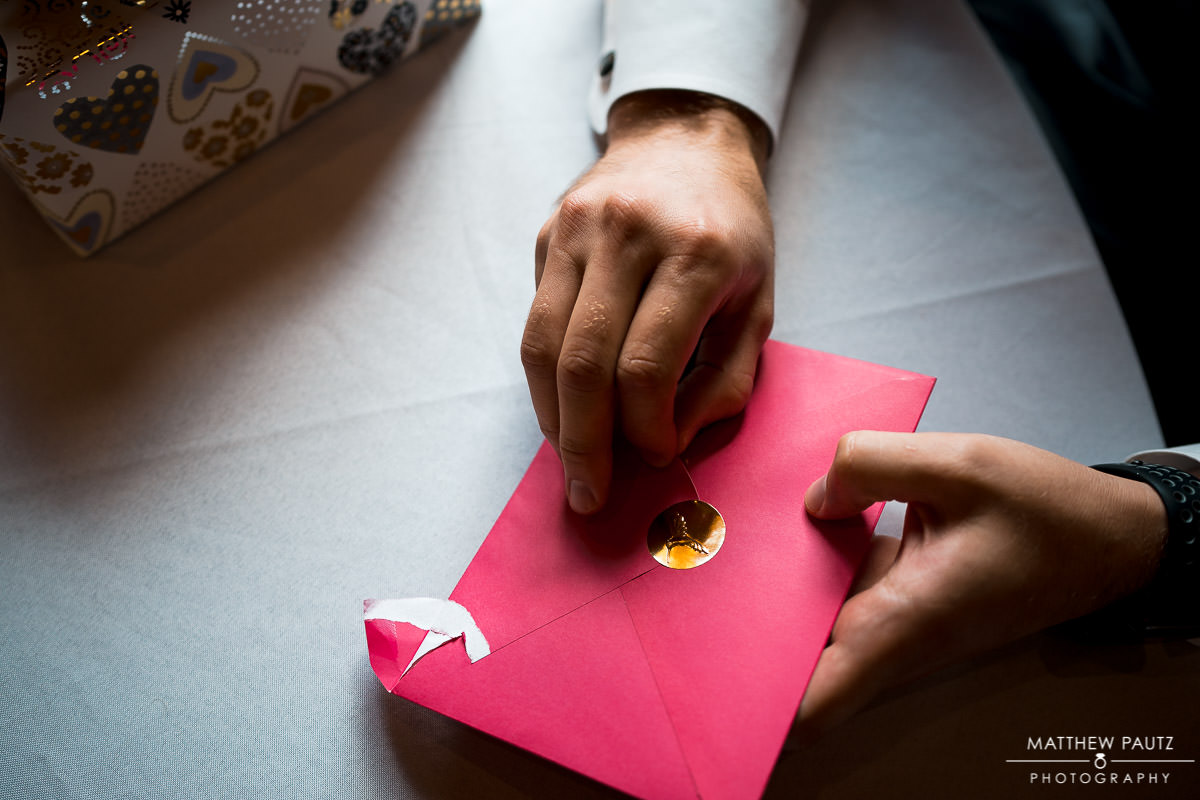 Groom opening letter from bride