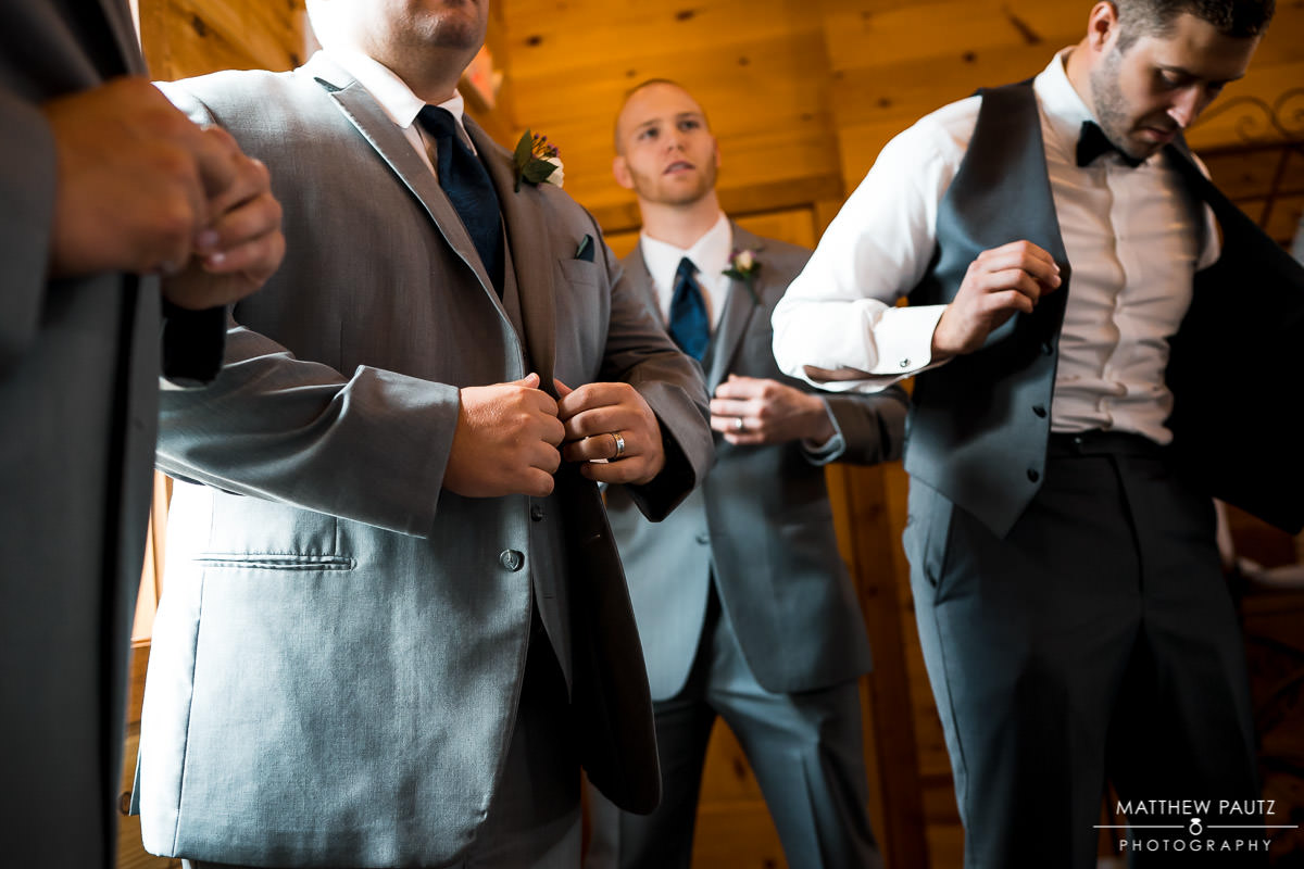 Groom and his groomsmen getting ready for wedding ceremony
