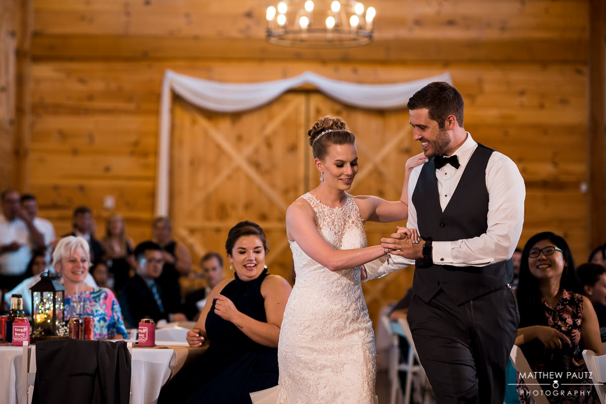 Newlywed couple's first dance at barn wedding