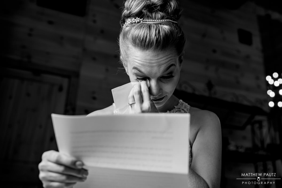 bride crying while reading letter from groom