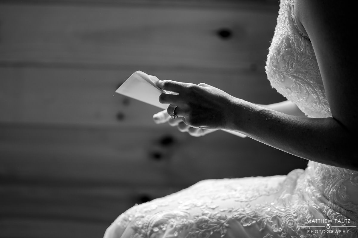 closeup of bride holding letter from groom