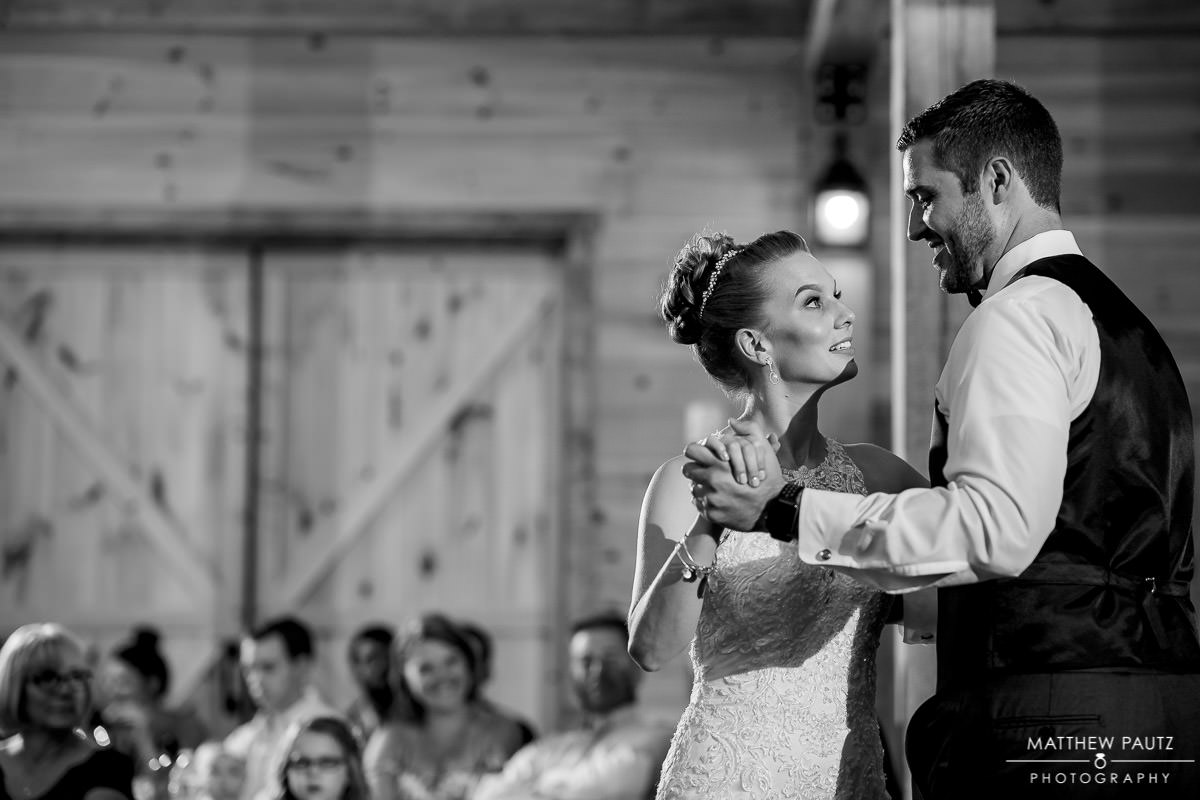 bride and groom dancing together at Windy Hill Barn wedding reception