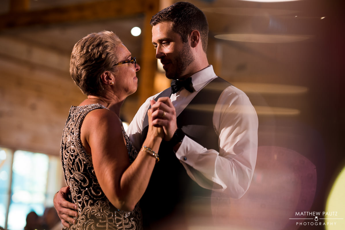 groom dancing with his mother at wedding ceremony