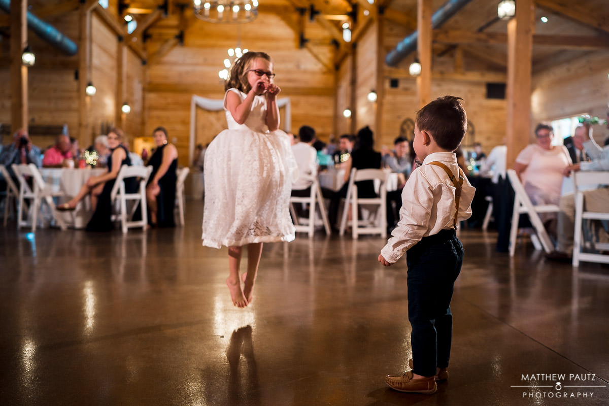 ring bearer and flower girls dancing at wedding reception