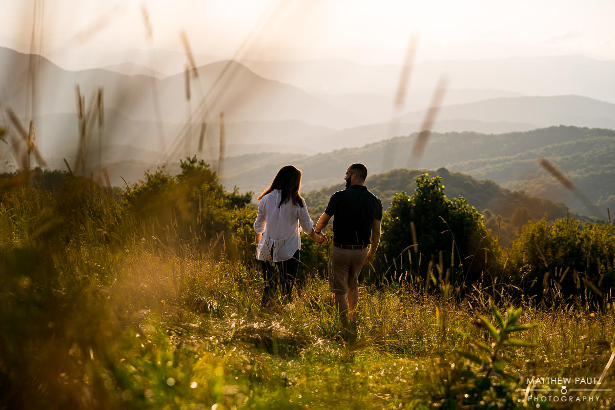 Couple walking into the mountains at sunset
