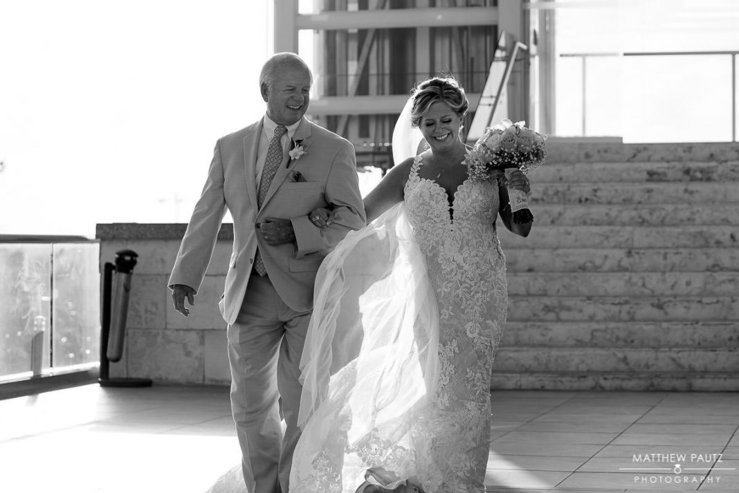 bride and her father walking down the aisle together