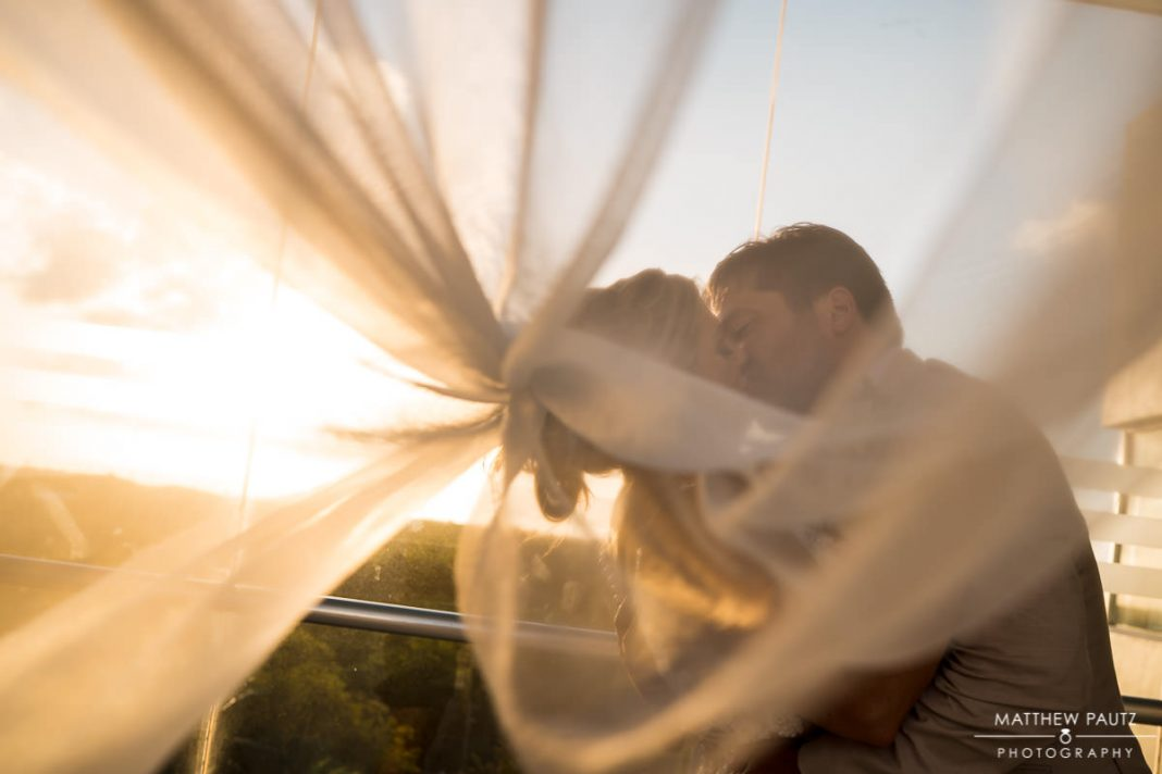 bride and groom under the veil at mexico destination wedding