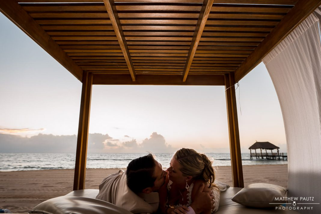 couple kissing in bali bed in playa del carmen