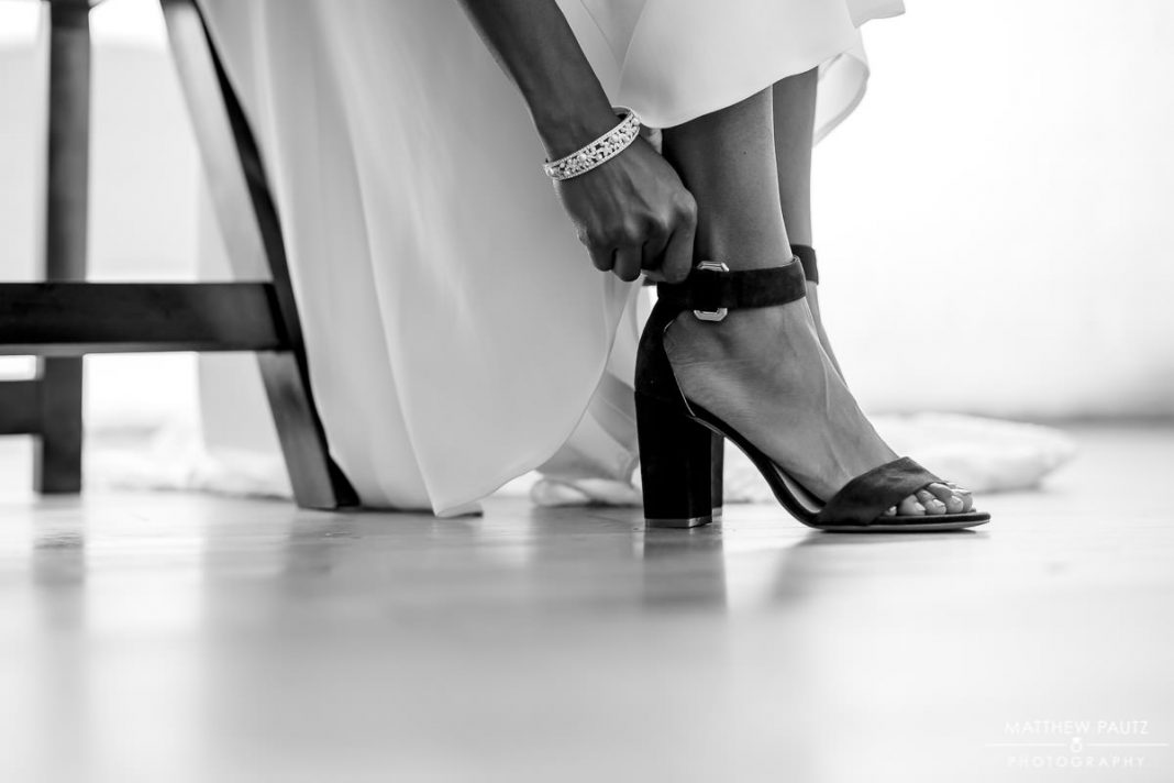 bride putting shoes on