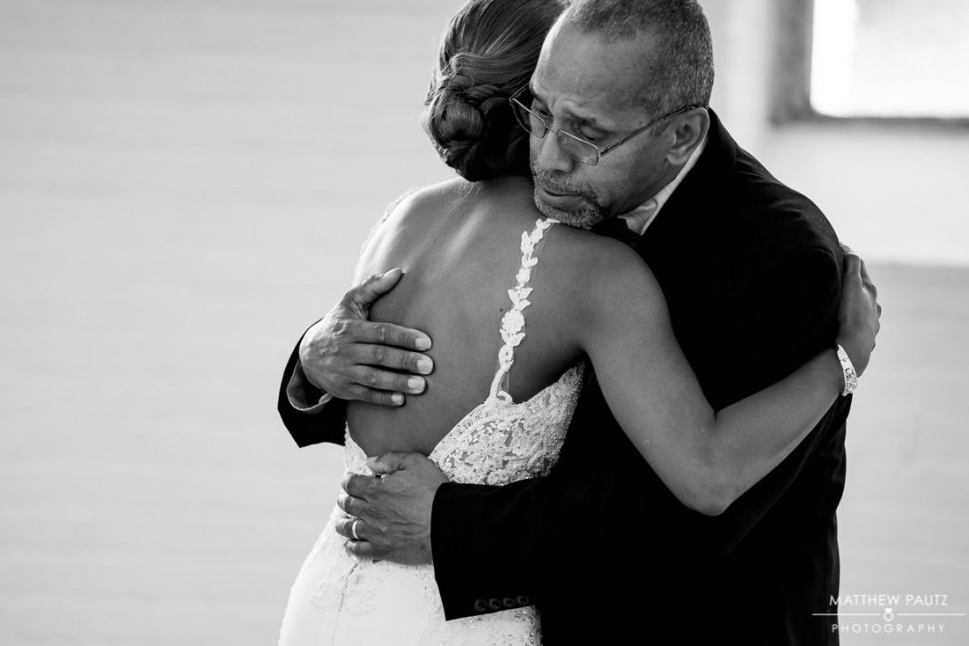 bride hugging her father before wedding ceremony
