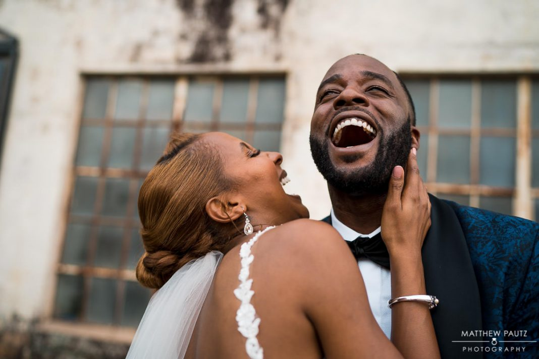 groom and bride laughing together at wedding