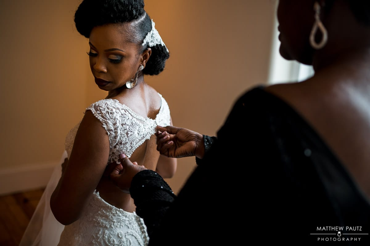 Bride getting dressed at 701 Whaley in columbia sc