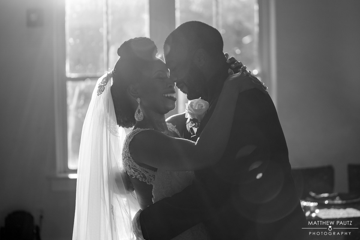 Silhouette of bride and groom dancing along at 701 Whaley