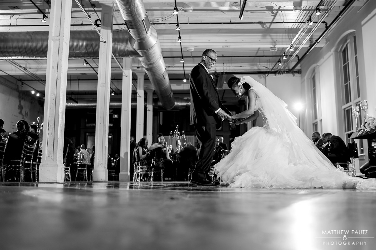 bride dancing with her father at wedding reception