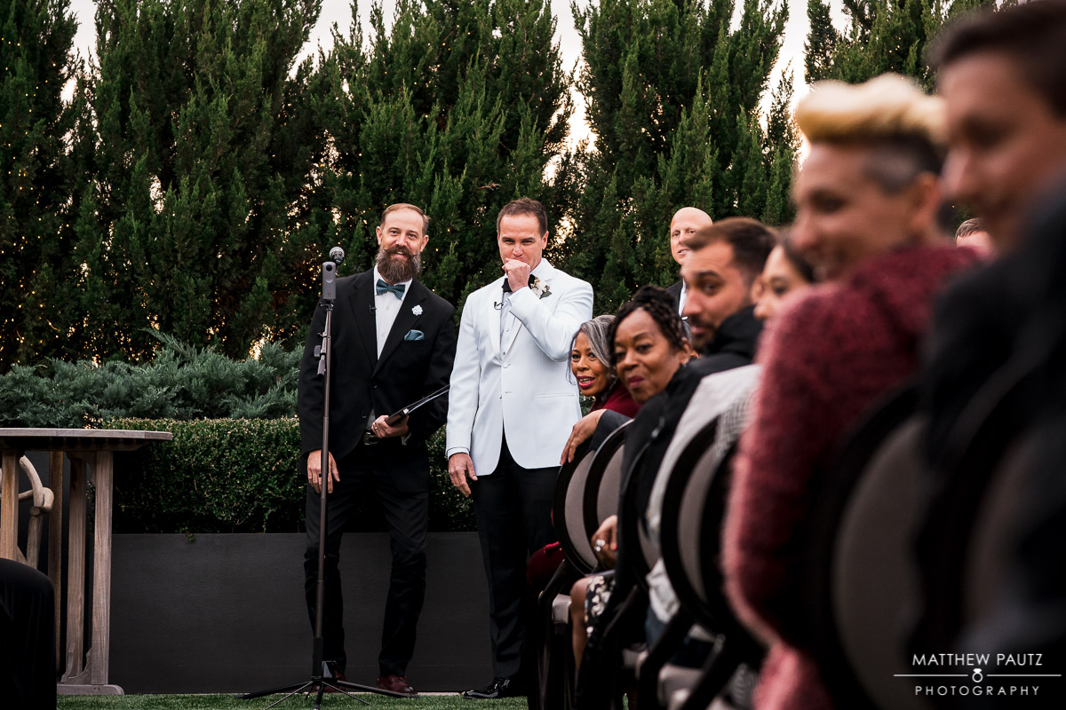 Groom tearing up after seeing bride walk down the aisle the first time