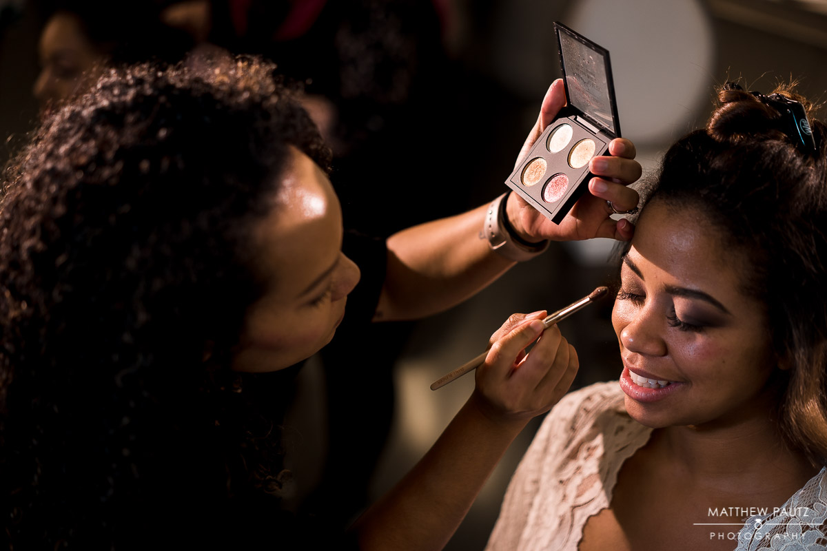Bride having makeup applied by Latia Curtis