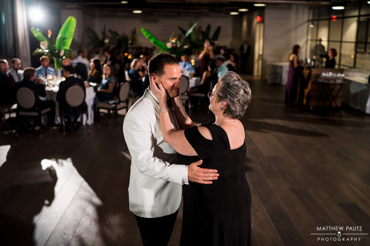 groom dancing with his mother during wedding reception