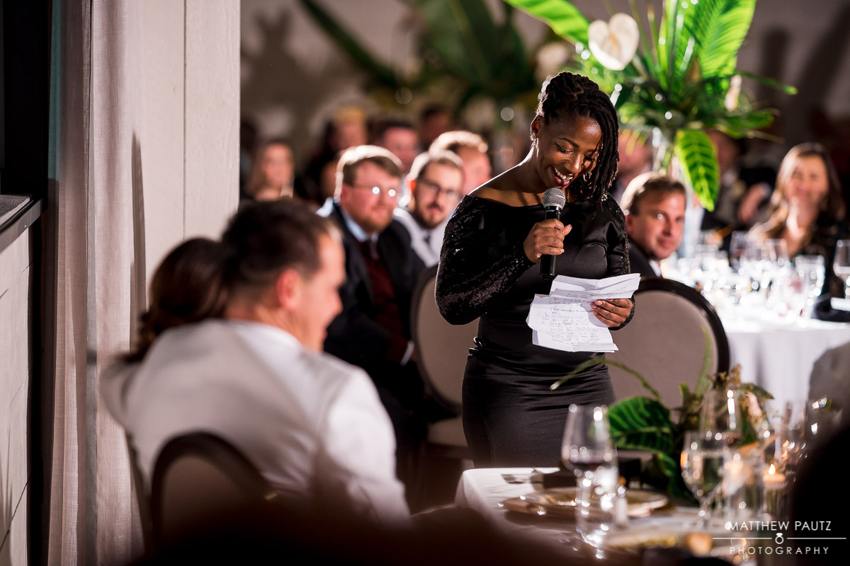 Maid of honor making speech during wedding reception