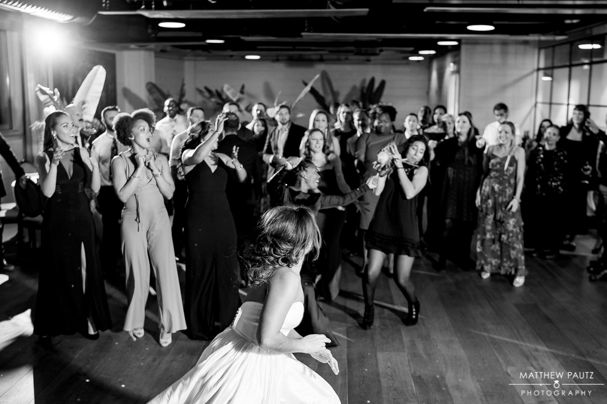 bouquet toss at wedding reception