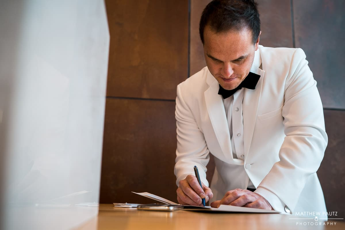 Groom writing personal letter to bride before wedding
