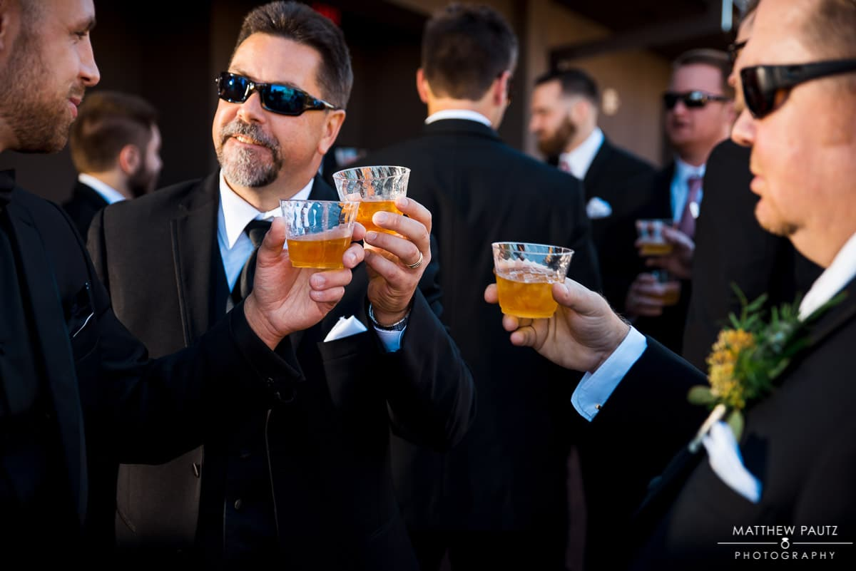 groomsmen toasting whiskey before wedding ceremony in Anderson Sc