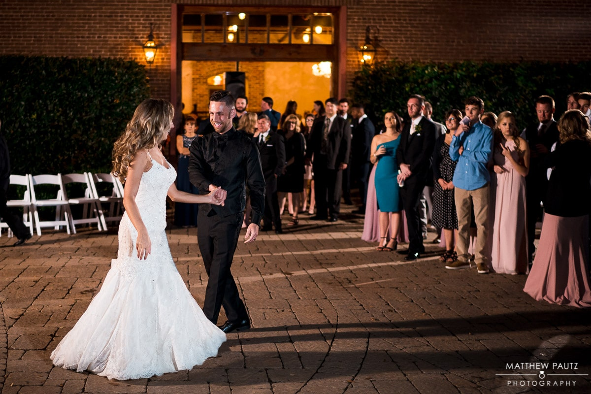 bride and groom's first dance at Bleckley Inn courtyard