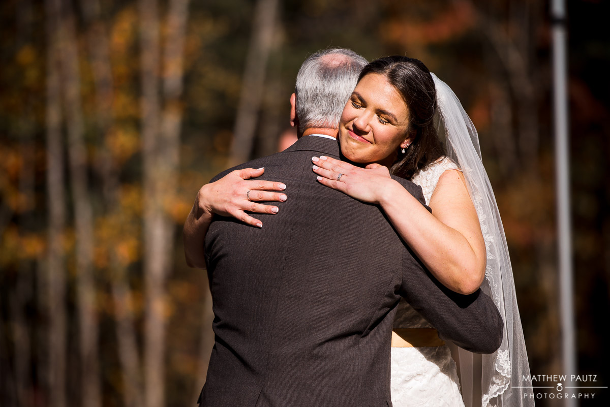 Bride hugging her father before wedding