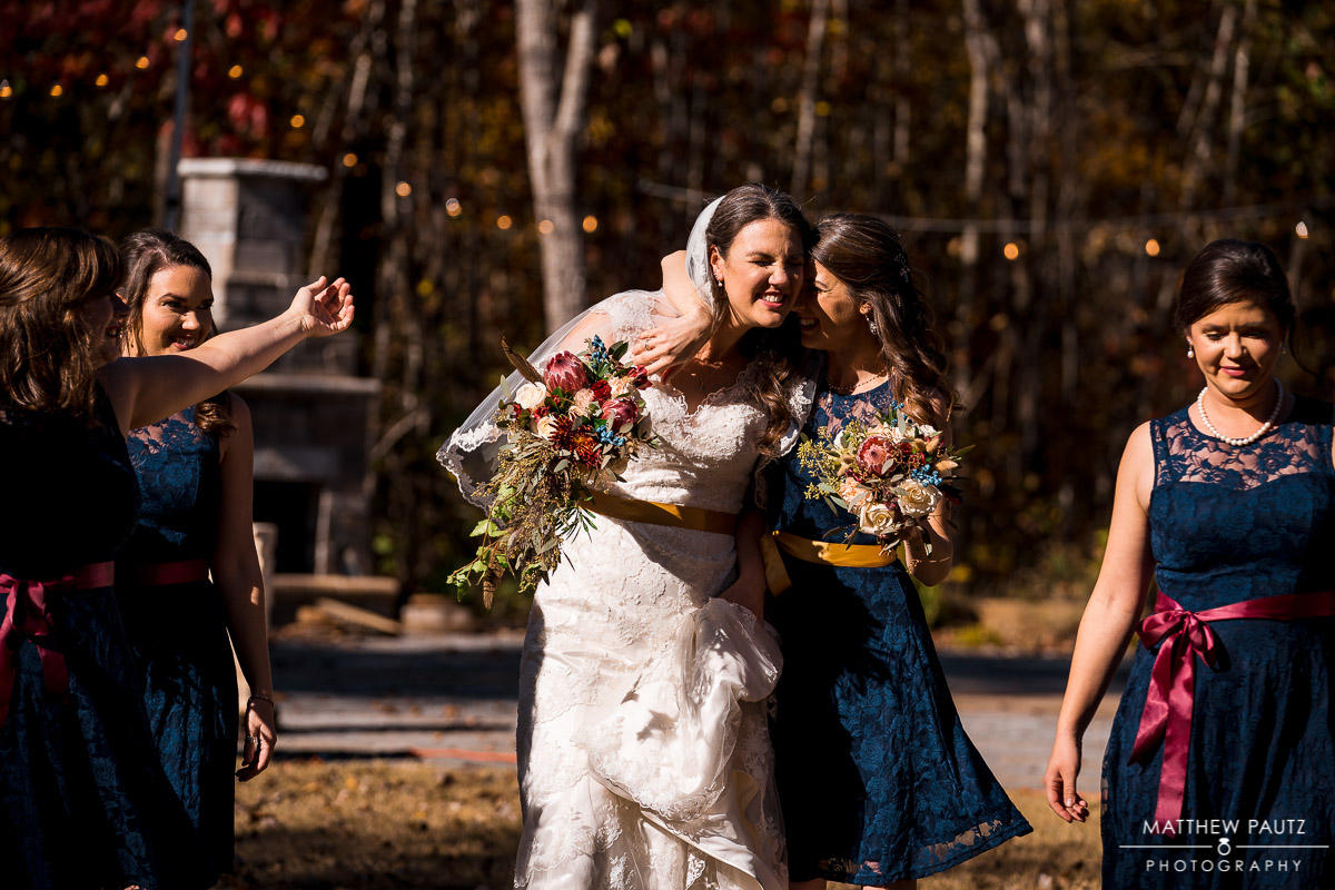 Bride walking with bridesmaids before outdoor wedding ceremony