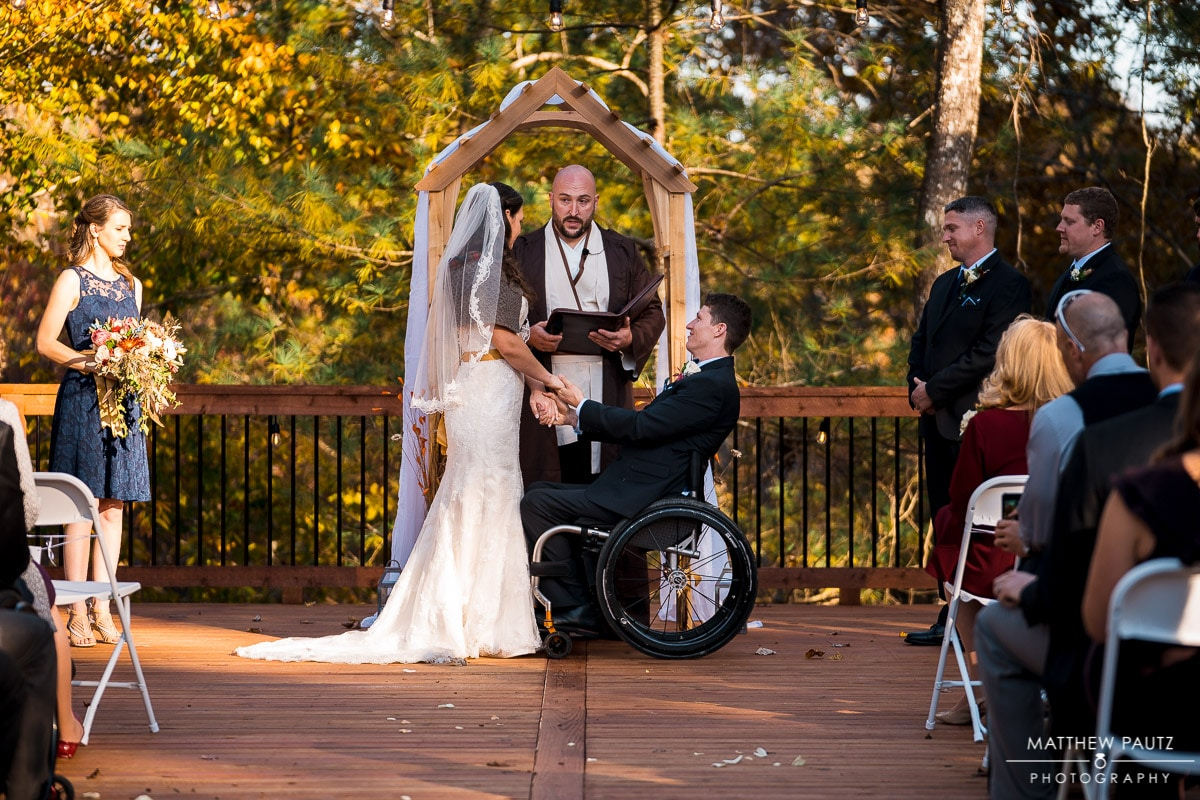 wedding ceremony photos with groom in wheelchair