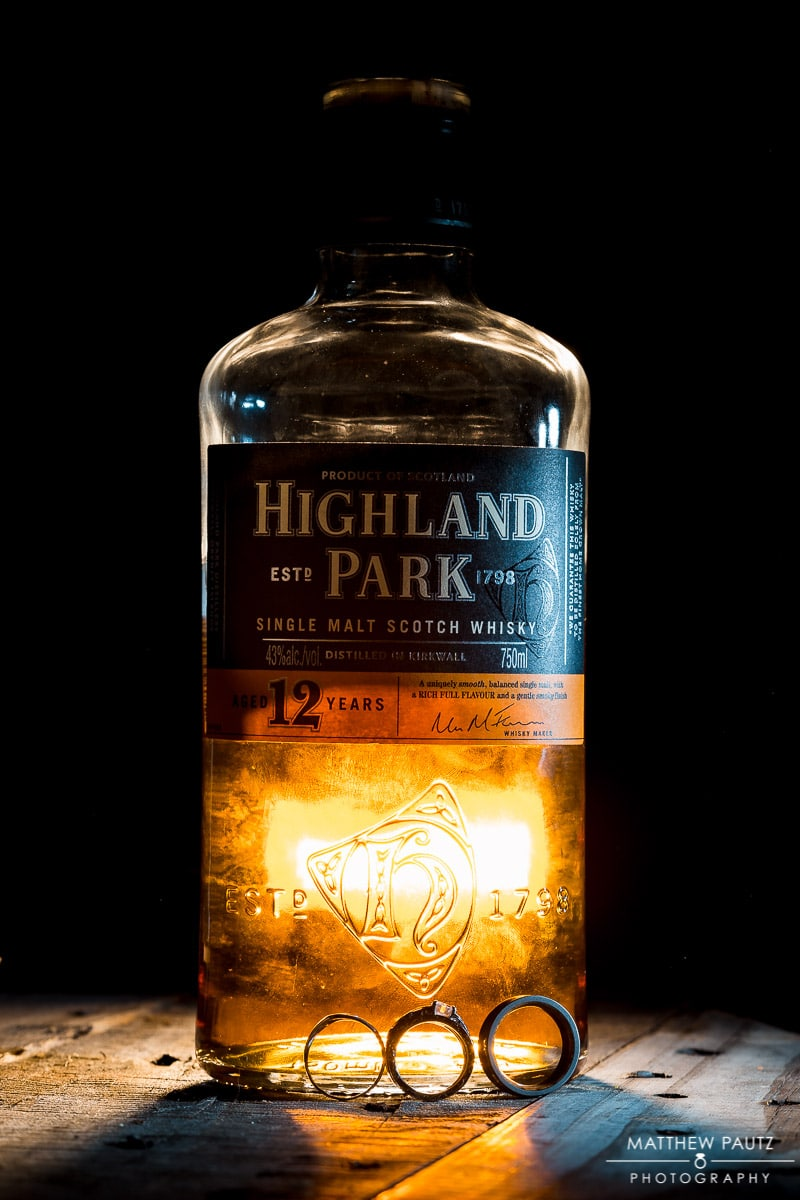 Wedding ring photos in front of bottle of Highland Park scotch whisky