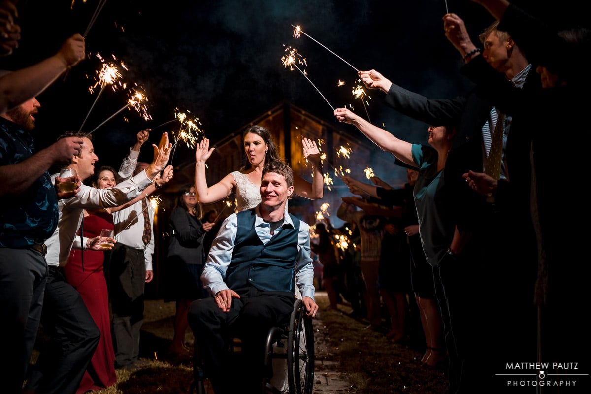 Bride and groom in wheelchair exiting wedding reception