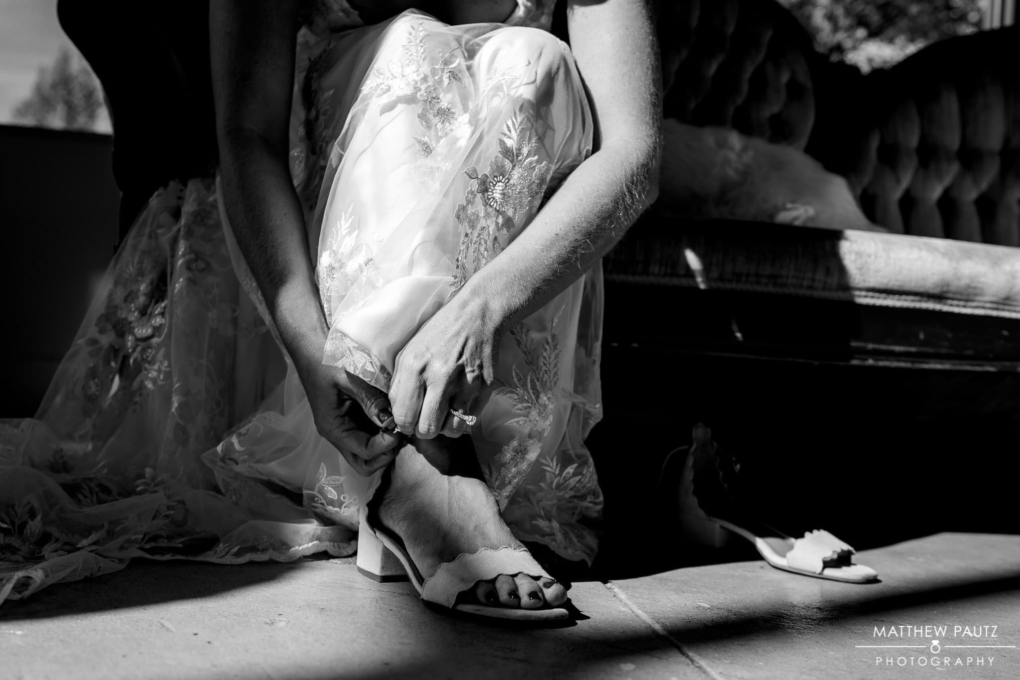 Bride getting dressed before wedding ceremony at Engaged Asheville, asheville nc