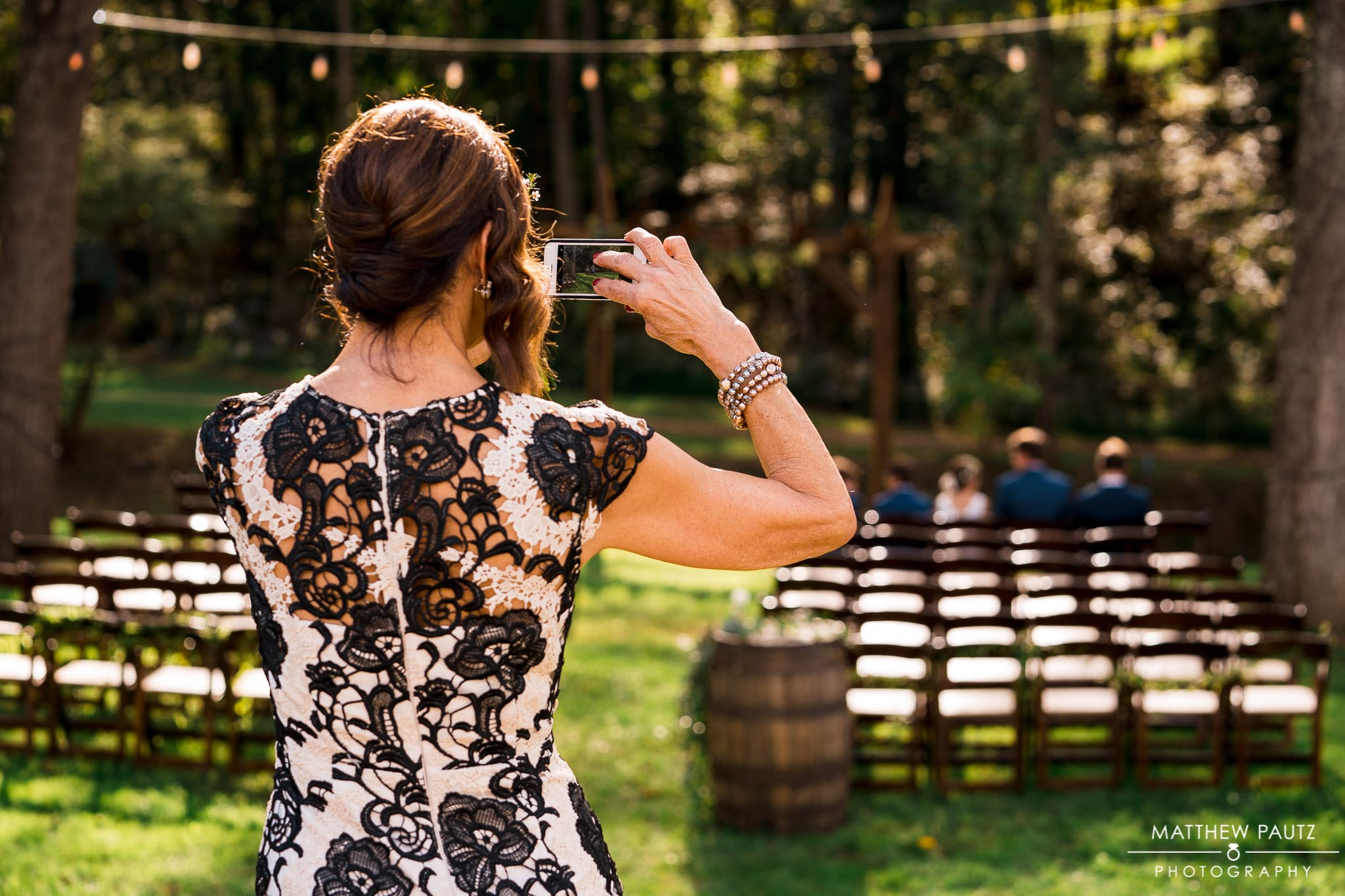 wedding guest taking photo of ceremony