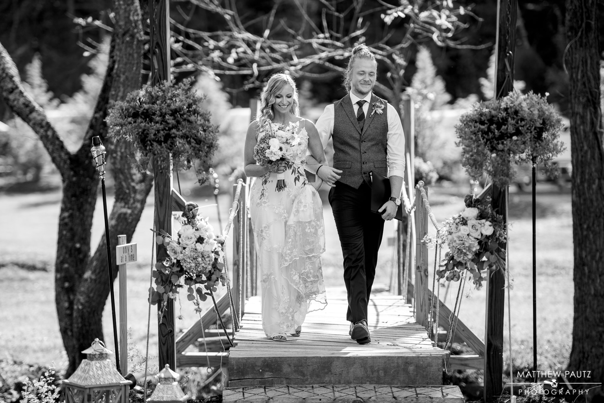 bride and her brother walking across bridge to ceremony at Junebug retro