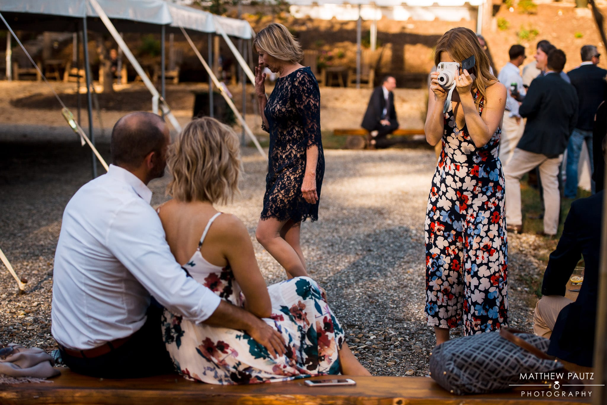 Wedding guests taking film photos of each other at reception