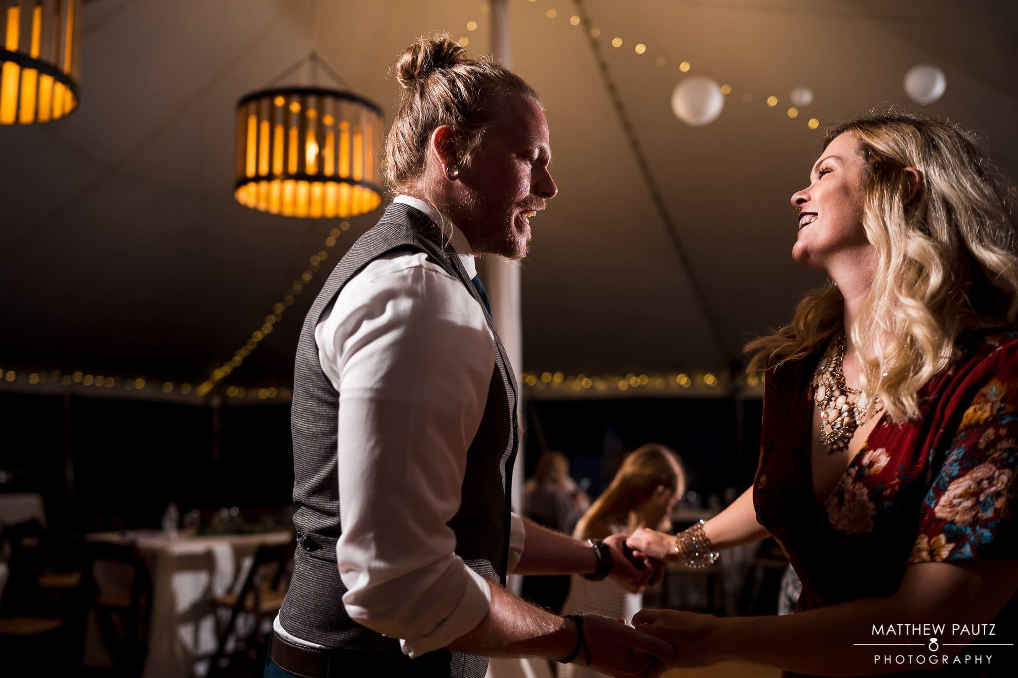 wedding guests having fun and dancing at wedding reception