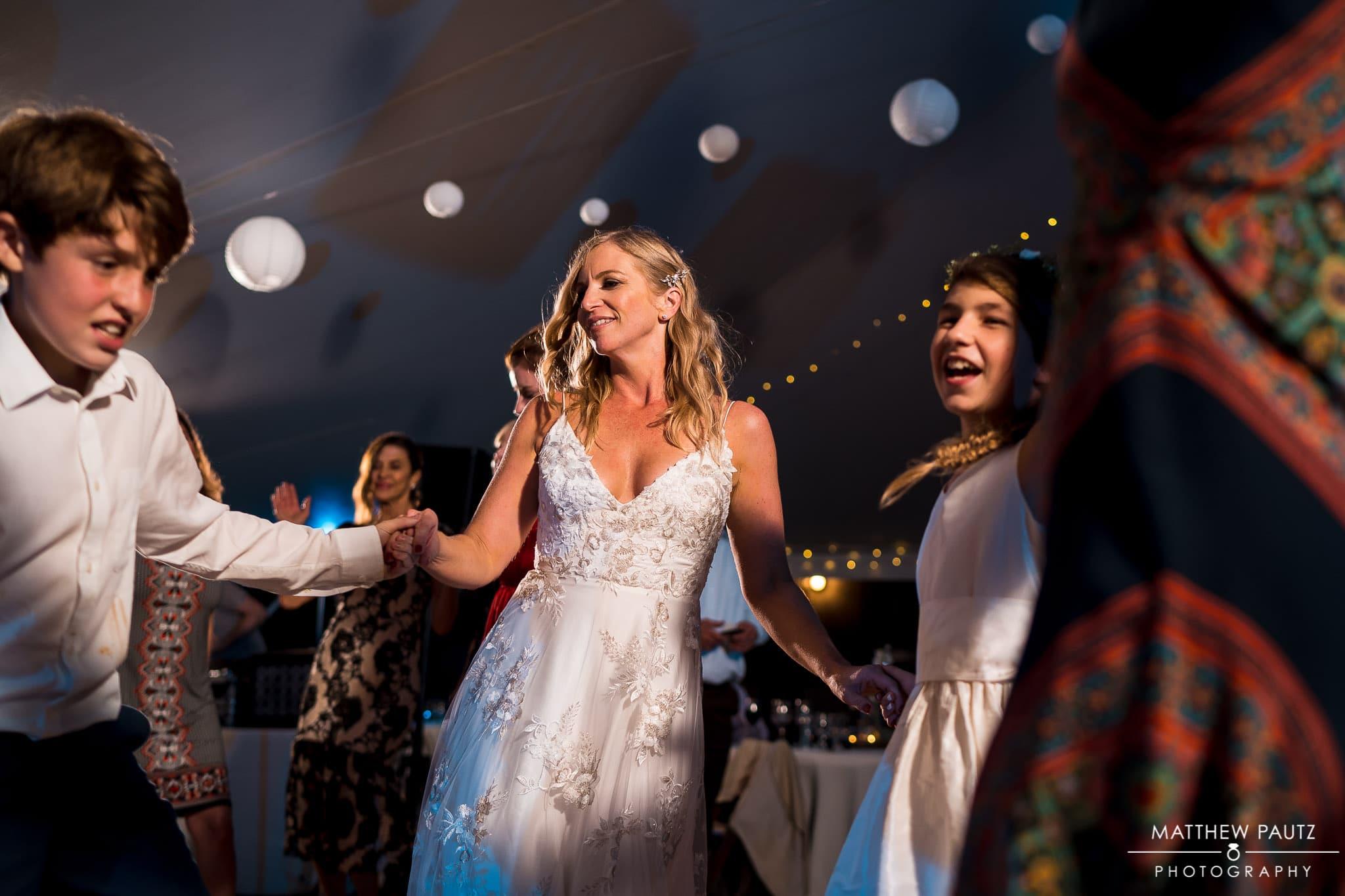 bride dancing at wedding reception at junebug retro resort