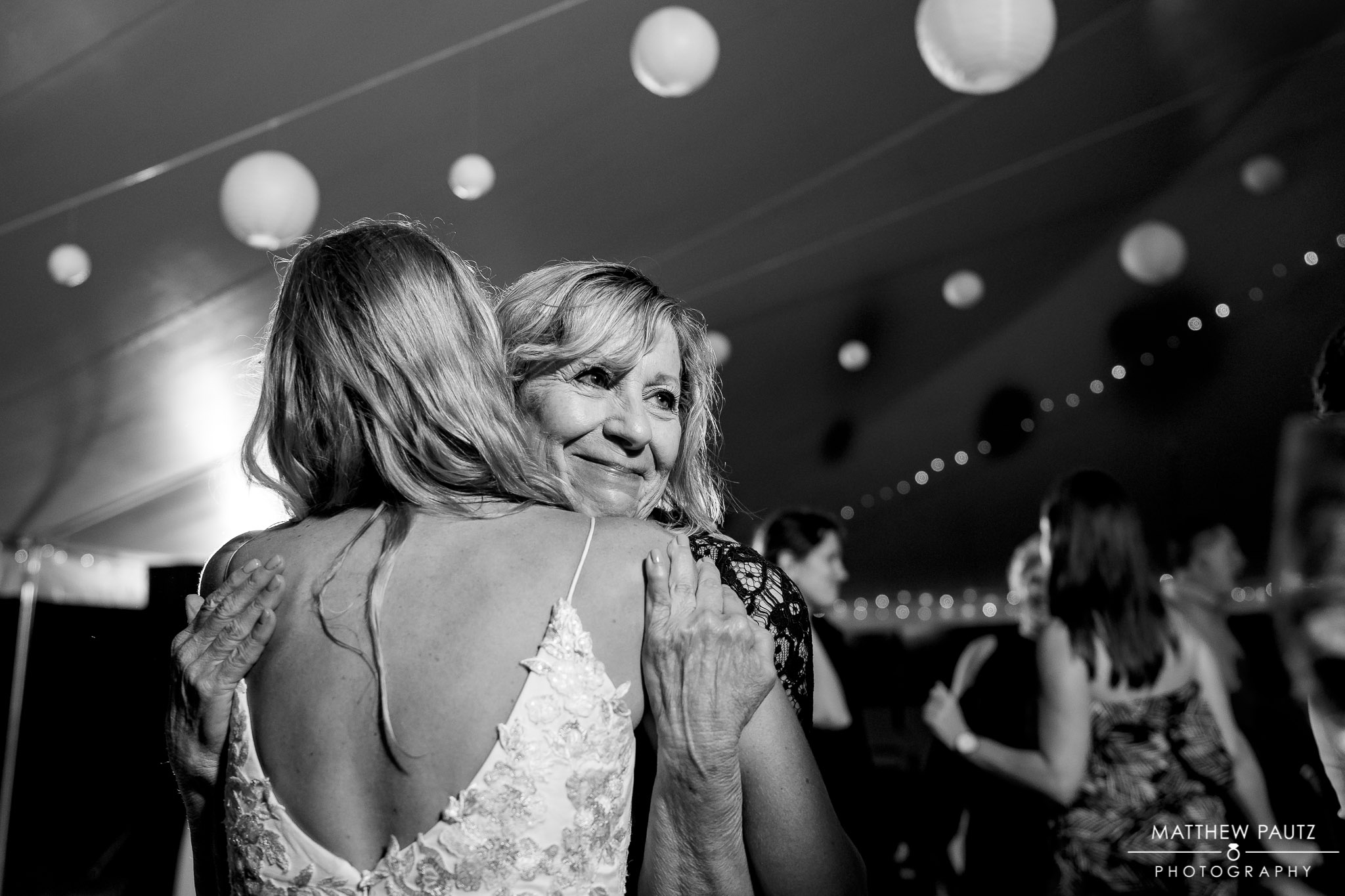 bride hugging her mother at wedding reception in asheville