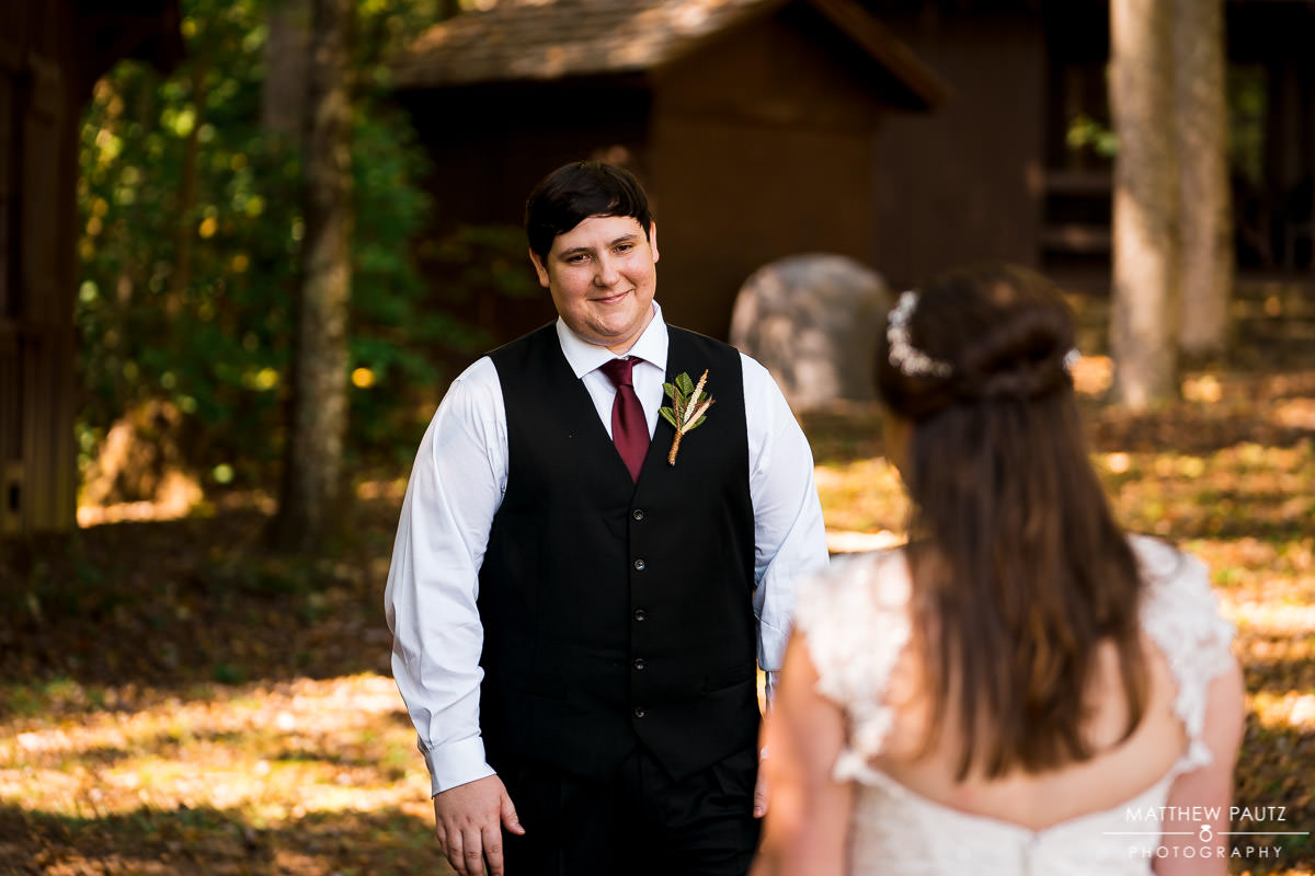 Groom seeing bride for the first time before wedding