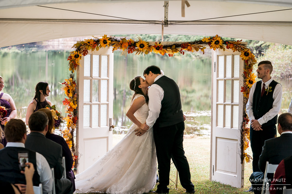 Bride and groom's first kiss at wedding