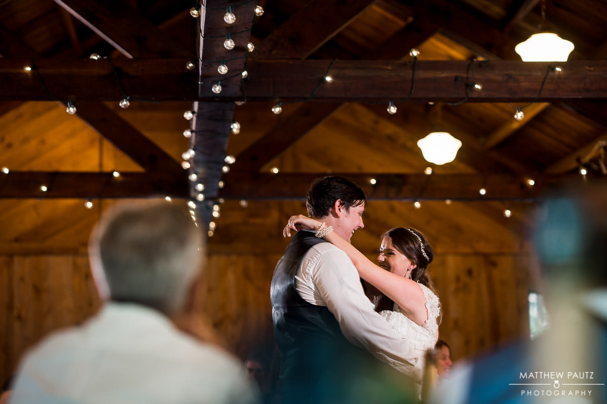first dance photos at cabin wedding reception